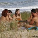 Picnic on nudist beach's picture