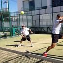 Playing padel tennis's picture